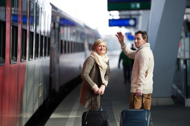 older couple train station