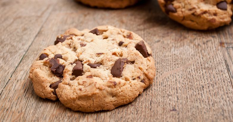 chewy chocolate chip cookies on wooden surface