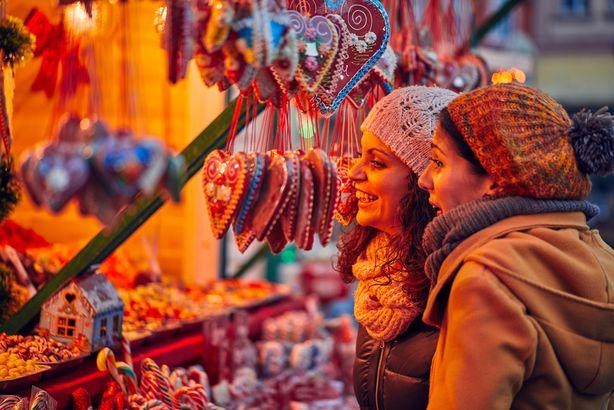 two friends enjoying Christmas market