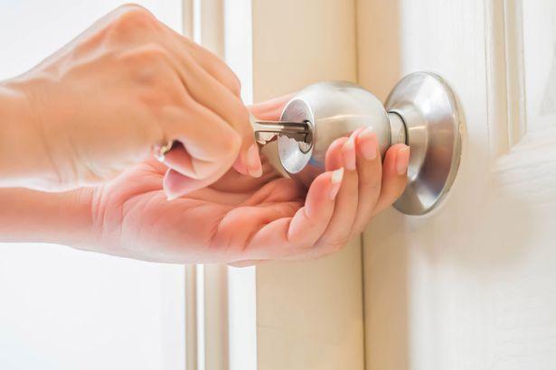 hands trying to unlock bedroom door