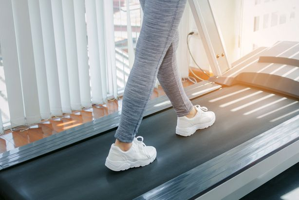 woman on a treadmill at home