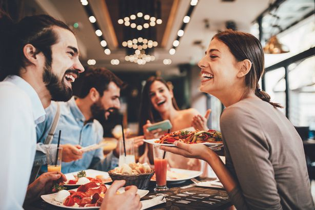Laughing friends in restaurant