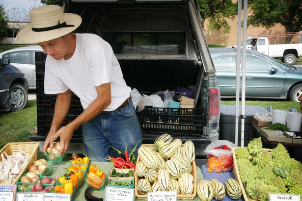 man selling locally grown produce