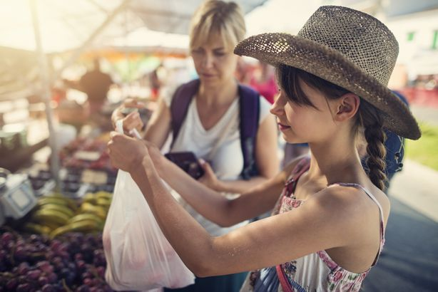 mom and daughter at the market
