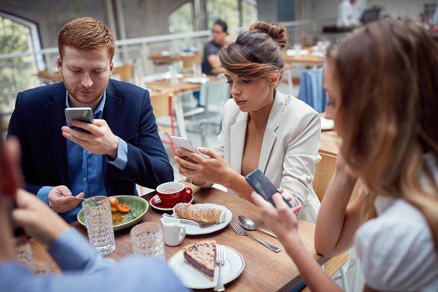 Restaurant patrons on phones