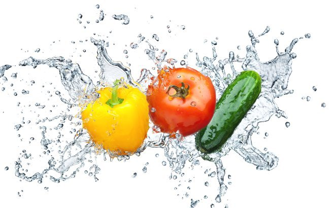 Juicy tomato, cucumber, pepper in spray of water