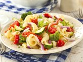 Homemade pasta salad with tomatoes, onions and broccoli