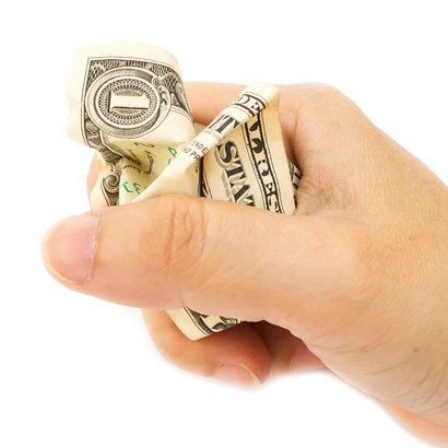 woman's hand grip a crumpled one dollar bill