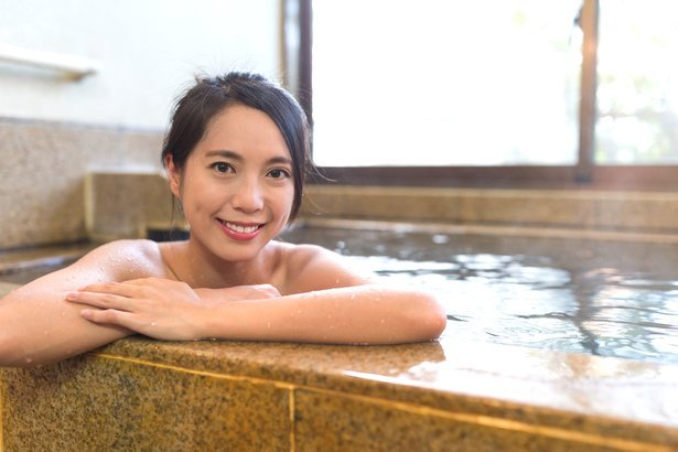 Japanese woman taking hot bath.