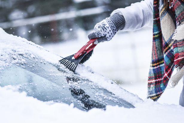 Scraping ice, snow off car