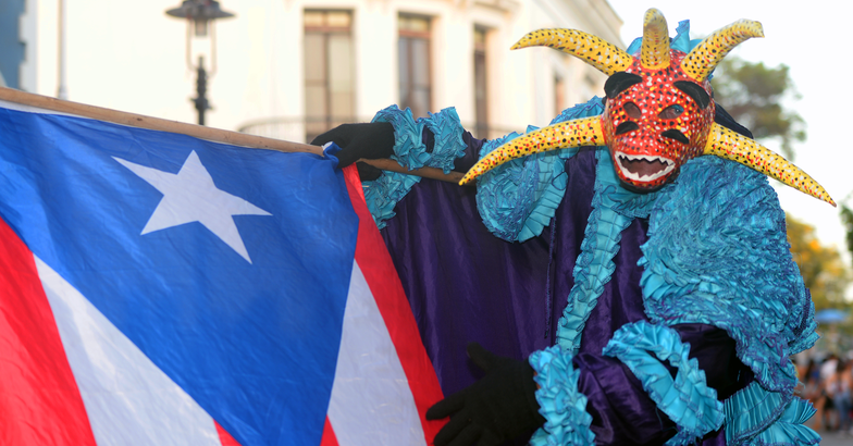 carnival vejigante with puerto rican flag