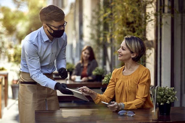 Woman talking to restaurant server