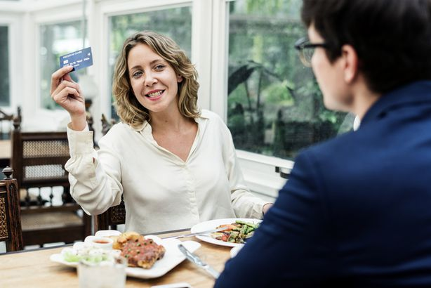 Woman holding up credit card